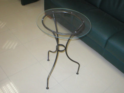 Decorative iron coffee table with glass top.