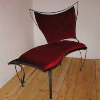 Decorative iron framed sofa with red plush upholstery