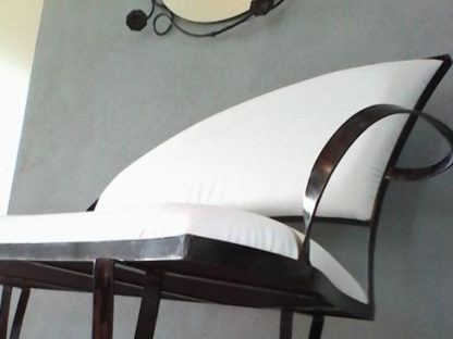 Decorative iron framed sofa with white eco-leather upholstery